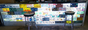 Student Roman Romero took a picture of a counter in Jeff's Used Parts of license plates from around the U.S.
