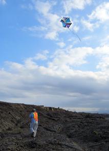 Stephen Scheidt flying a kite over the December 1974 flow in Hawaii.  (Image: Laura Kerber)