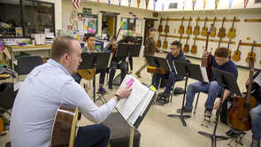 Steven Lerman (left), who just completed his Doctor of Musical Arts at the UA, helps teach guitar in the Lead Guitar program at Amphitheater High School. (Photo: Bob Demers/UANews)