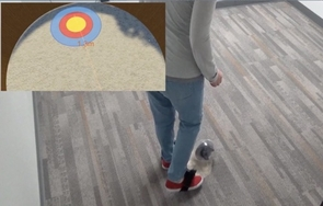 "In the ""Tangiball"" experiments, users kicked a real ball toward a virtual target. The image in the upper left corner shows what the user saw through the headset. (Courtesy of XRG Lab)"