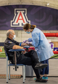 UA Police Chief Brian Seastone has his blood drawn for antibody testing. (Photo: Chris Richards/University of Arizona)