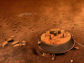 In this image reconstructed from Huygens data in 2006, the probe is pictured in a hole it excavated during impact. Now, using all data available, scientists have refined the sequence of events and discovered that the probe bounced out of its hole and slid sideways before coming to rest on undisturbed terrain. (Image: NASA)