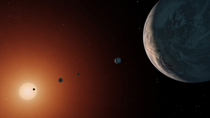An artist's concept for a view of the TRAPPIST-1 system from near TRAPPIST-1f. The system is located in the constellation Aquarius and is just under 40 light-years away from Earth. Image credit: NASA/JPL-Caltech