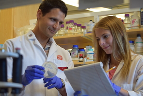 Samuel Campos (left), associate professor in the Department of Immunobiology, will work with a team of researchers to investigate how the evolutionary adaptation of a key viral structure may have enabled this novel strain to cause rapid worldwide disease. (Photo: Nicole Swinteck/Department of Immunobiology)
