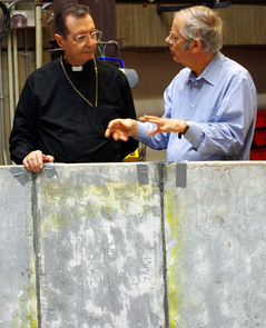 Lajolo (left) and Mirror Lab director Roger Angel are pictured beside part of the mold wall that will be used in making a giant mirror at the lab later this year.