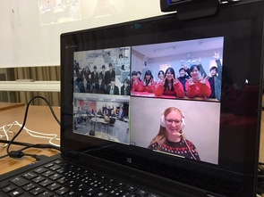 Students from Changemaker High School (bottom left) and UA master's student Sarah Johnson (bottom right) meet via videoconference with teens in Japan. (Photo courtesy of Kaito Abe)