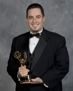 Erick Moreno poses with one of his Emmys.