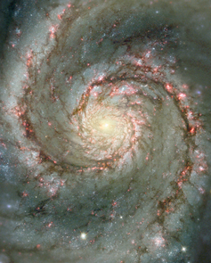 This Hubble composite image of the Whirlpool galaxy, or M51, shows visible starlight as well as light from the emission of glowing hydrogen, which is associated with the most luminous young stars in the spiral arms. This Wide Field Planetary Camera 2 image enabled a research group including UA astronomers Rodger Thompson and Marcia Rieke to resolve intricate details of the galaxy's structure. (Credit: NASA and the Hubble Heritage Team (STScI/AURA) Acknowledgment: N. Scoville (Caltech) and T. Rector (NOAO))
