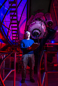 John Cocke next to the 21-inch telescope at Steward Observatory on the UA campus. (Photo courtesy of Nathaniel Johnston/njohnstonphotography.com)
