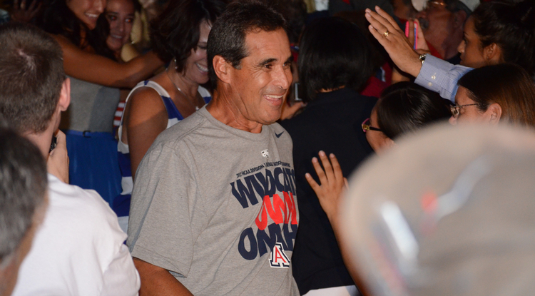 Baseball coach Andy Lopez is greeted by fans at a welcome-home event in McKale Memorial Center. (Photo by Patrick McArdle/UANews)