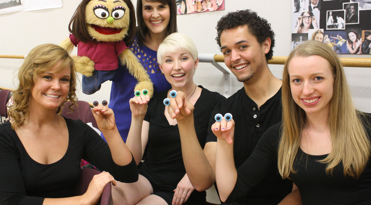 "UA alumna Michelle Lane (with puppet) performed in the Las Vegas cast of ""Avenue Q"" and the role of Dory in the stage production of of ""Finding Nemo, the Musical,"" among other professional presentations. Lane returned to the UA this semester for the first time since graduating in 2000 to help train UA students for their upcoming presentation of ""Avenue Q."" (Photo credit: Beatriz Verdugo/UANews"