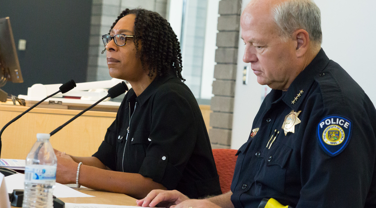 Kendal Washington White (left), the UA's dean of students, and UAPD Chief Brian Seastone discuss the annual Campus Safety, Security and Fire Report. (Photo: Bob Demers/UANews)