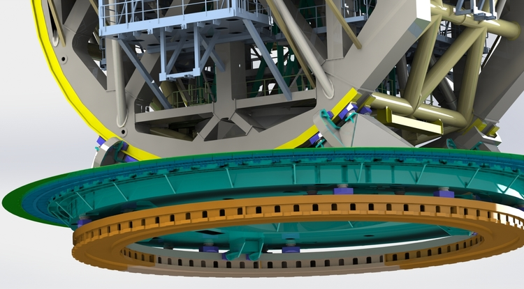 The Giant Magellan Telescope is engineered to rest on azimuth bearings. The orange ring at the bottom will be connected to the concrete pier and does not rotate. The blue pads on top of this fixed track support the entire mass of the telescope. (Image: Giant Magellan Telescope/GMTO Corporation)