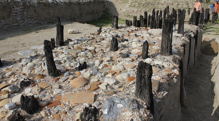 Ballast stones and broken ceramic vessels lie scattered among harbor pilings at this Byzantine harbor site excavated near the Turkish capital, Istanbul. (Photo: Charlotte Pearson)