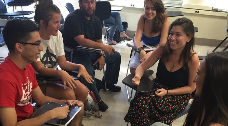 Kerri Lopez, community life director for House of Neighborly Service, visited with students in Anthropology 200 to discuss progress on their research project.