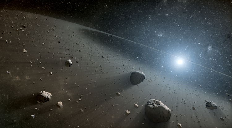 This artist's concept illustrates an asteroid belt around the bright star Vega. Evidence for this warm ring of debris was found using NASA's Spitzer Space Telescope, and the European Space Agency's Herschel Space Observatory, in which NASA plays an important role. (Image: NASA/JPL-Caltech)