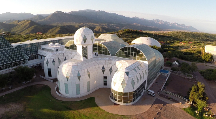 The Biosphere 2 complex in Oracle, Arizona, is a unique, large-scale experimental research facility housing seven simulated ecosystems.