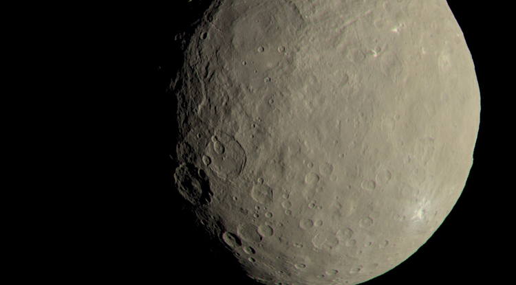 This image of Ceres approximates how the dwarf planet's colors would appear to the eye. This view of Ceres, produced by the German Aerospace Center in Berlin, combines images taken during Dawn's first science orbit in 2015 using the framing camera's red, green and blue spectral filters. (Image: NASA)