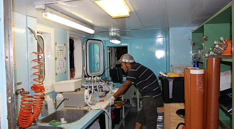 J. Cesar Ignacio Espinoza, a UA doctoral student in Sullivan's lab and co-first author on the Nature paper, in a mobile lab set up on a research cruise to sample viruses in the ocean. (Photo: Sullivan lab)