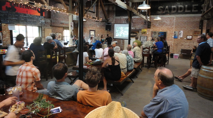UA scientist presents his research to the Tucson Community at Borderlands Brewing in an intimate, friendly setting as part of the Science Cafe series. (Photo Credit: Erin Deely)