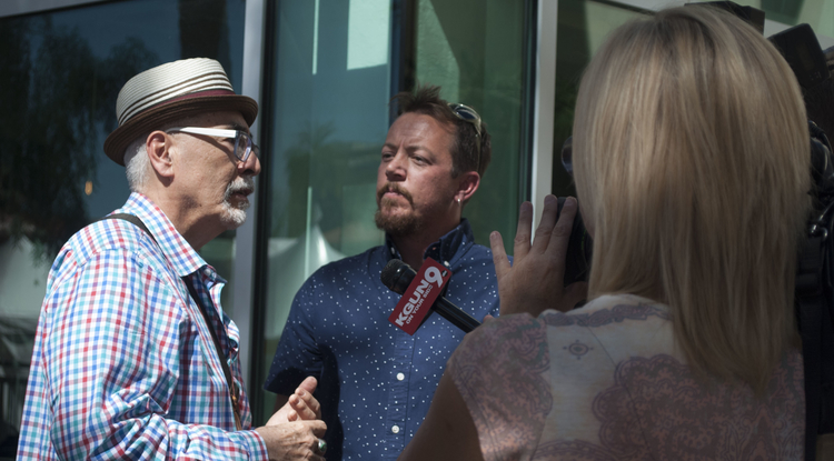 TC Tolbert (center), who earned a Master of Fine Arts in poetry from the UA, is a poet of stature. Tolbert has been named as Tucson poet laureate. U.S. poet laureate Juan Felipe Herrera (left) attended the announcement at the UA. (Photo: Sarah Ann Gzemski/UA Poetry Center)