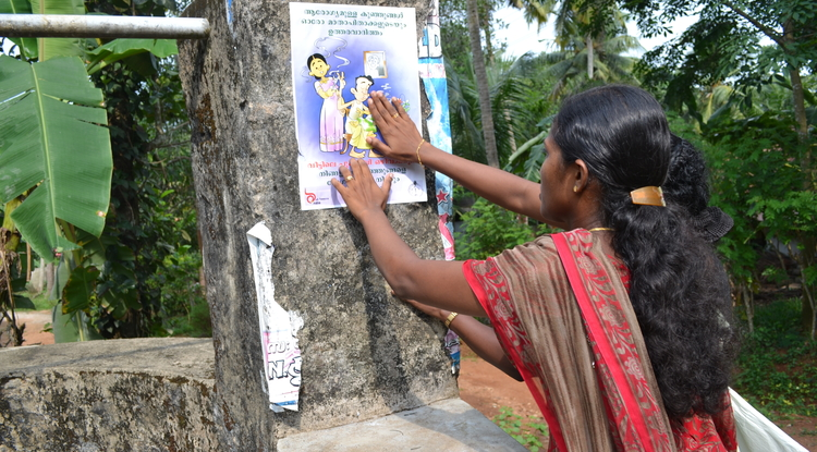 Project Quit Tobacco International's smoke-free homes initiative encourages men in India and Indonesia to smoke outdoors in order to limit their wives' and children's exposure to secodhand smoke. Signs are used to indicate a home's intent to be smoke-free.