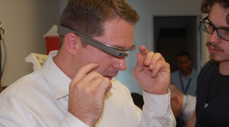 Fourth-year UA College of Medicine – Phoenix students Christian Dameff (left) and Jeff Tully (right) demonstrate the Google Glass device.