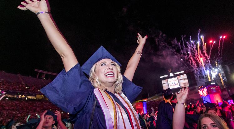 Katie Alhadeff, a business management graduate, celebrates at the close of the Commencement ceremony. (Photo: John de Dios/UA News)
