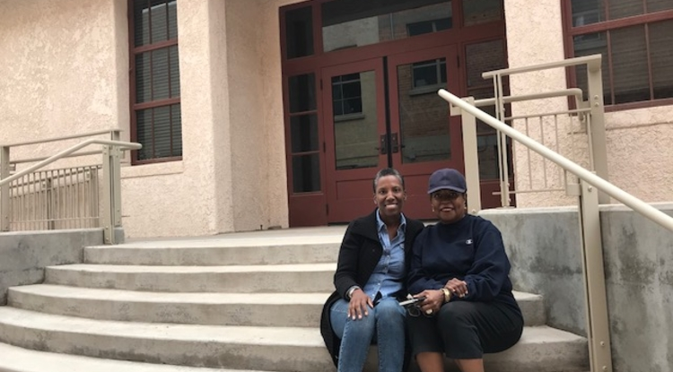 Debi Chess Mabie and Chyrl Lander on the steps of the Dunbar Pavilion. The women want the pavilion to be a gathering place for diverse voices and cultures and to increase the understanding of the historic and cultural impact of people of African descent.