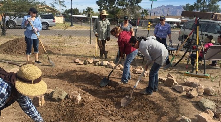 Community health workers (promotoras) complete a hands-on workshop on passive rainwater harvesting systems. They will conduct community outreach and assist their neighbors with rainwater harvesting projects in Arizona. (Photo: Ann Marie Wolf)