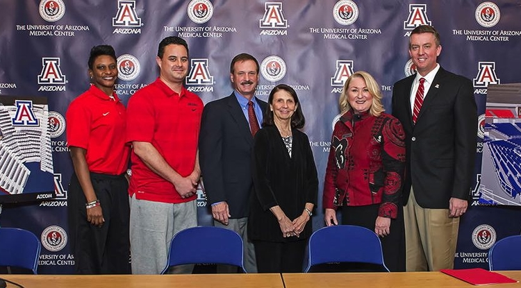 Tucsonans Cole and Jeannie Davis (center) have made yet another significant contribution to the UA athletics department. Pictured with the Davises are (left to right) head women's basketball coach Niya Butts, head men's basketball coach Sean Miller, UA President Ann Weaver Hart and Greg Byrne, director of athletics. (Photo courtesy of Arizona Athletics)