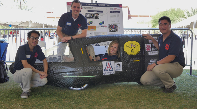 Kyle Daughenbaugh, standing behind the human-powered vehicle he built with teammates (from left) Dustin Huynh, Maurissa Wortham and Christian Brown, translated his work on the 2015-2016 senior design project to working for Caterpillar.