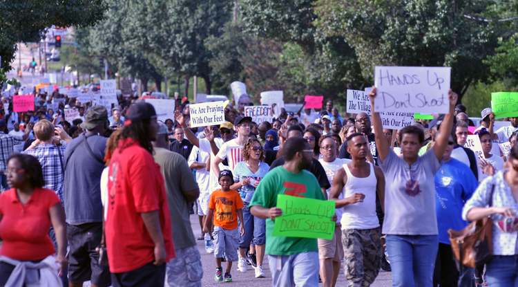 Protesters march in the aftermath of the Aug. 9 shooting death of Michael Brown in Ferguson, Mo. (Photo courtesy of Loavesofbread via Wikipedia)