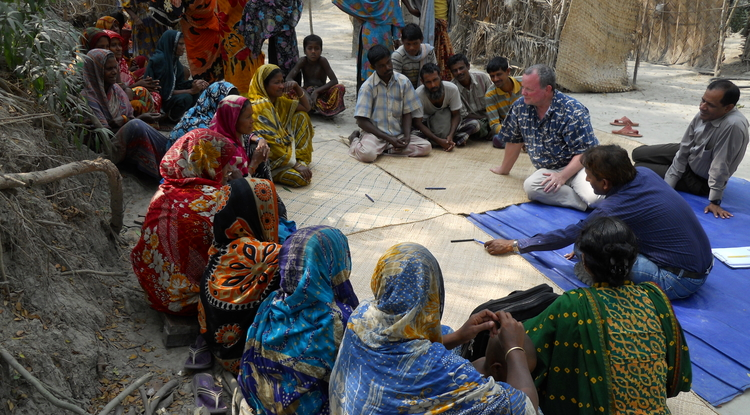 UA anthropology professor Tim Finan talks with villagers in Barisal, Bangladesh about their recovery from Cyclone Sidr in 2009. Finan will direct the UA's new Master's in Development Practice degree program, which will be offered for the first time this fall.