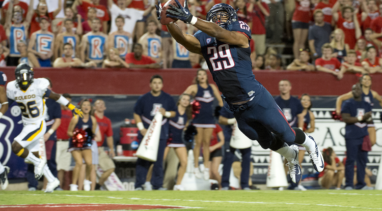 Austin Hill catches a pass during last week's game against Toledo.