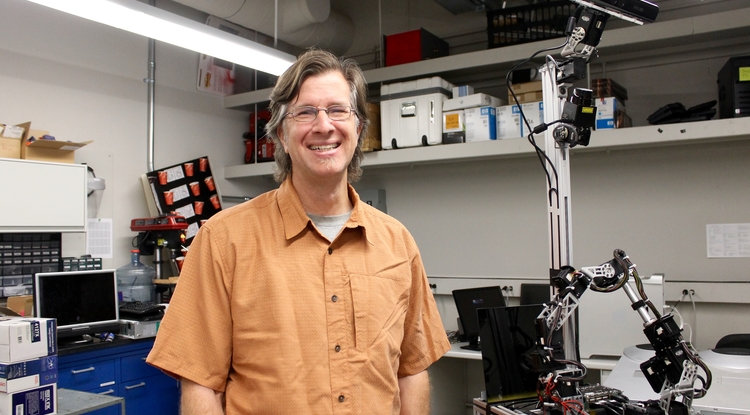 School of Information associate professor Clayton Morrison in his robotics lab (Photo: Emily Litvack/UANews)