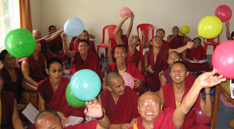 "Monks release their ""universes"" after an experiment to measure Hubble expansion using balloons as analogs for curved space-time. (Photo: Chris Impey)"
