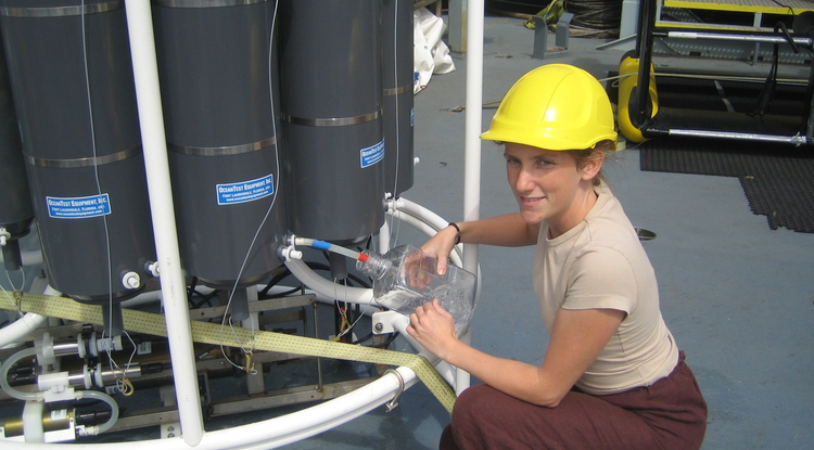 Karin Holmfeldt, the study's first author, aboard a research vessel sampling viruses in the Atlantic Ocean. (Photo: Marie Louise Kjaergaard Schroter)