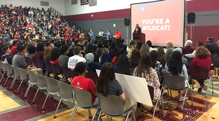 Kasey Urquidez, the UA's vice president for Enrollment Management and Student Affairs Advancement, informs a group of Desert View High School seniors that they have been accepted to the UA. (Photo: Kimberly Davis/UANews)