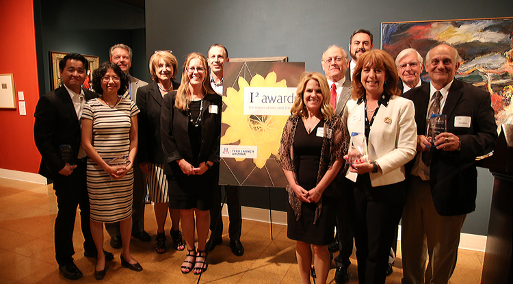 From left: Jeffrey Pyun, Bibiana Law, TLA Vice President David Allen, UA President Ann Weaver Hart, Heather Gaines, Joseph Valacich, Anne Stratman, Lawrence Hecker, Manny Teran, Laura Todd Johnson, Laurence Hurley and Dominic Gervasio.