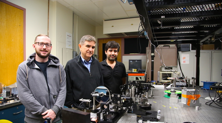 From left: Joshua Olson, a graduate student studying ultrafast fiber lasers; Nasser Peyghambarian; and Veyesi Demir, a postdoctoral researcher working on optical computing. (Photo: Paul Tumarkin/Tech Launch Arizona)
