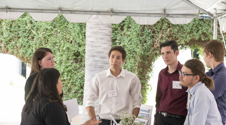 From left: Rachel Cardona and Erica Holt from Vanguard discuss opportunities with CALS students Brian Caplan, Donald Coon, Alex Feldman and Jack Welchert, all from the Controlled Environment Agriculture Student Association. (Photo: Lynn Ketchum)