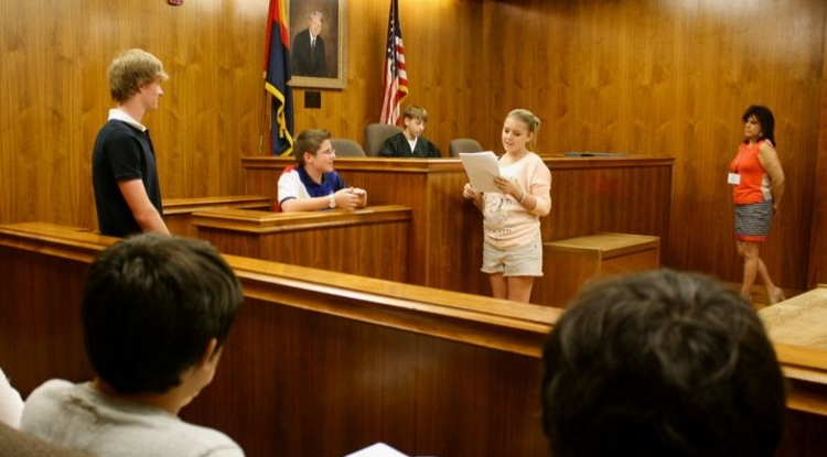 This week, high school students are participating in the UA Youth University's Law Camp. During the camp, students have the opportunity to take the role of a judge, prosecutor, defendant, victim, bailiff and members of the jury with the guidance of scholars, instructors and those practicing in the field. (Photo by Beatriz Verdugo/UANews)