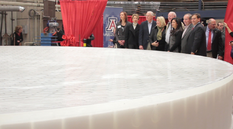 UA President Ann Weaver Hart and guests join in unveiling GMT mirror number 3. (Photo: Carina Johnson/UANews)