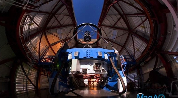 The Magellan Telescope with MagAO's Adaptive Secondary Mirror (ASM) jmounted at the top looking down some 30 feet onto the 21-foot diameter primary mirror, which is encased inside the blue mirror cell. (Photo: Yuri Beletsky, Las Campanas  Observatory)