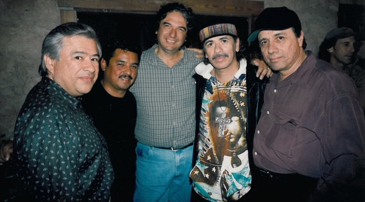 Moctesuma Esparza (left) with an unidentified individual and also director Gregory Nava, Carlos Santana and Edward James Olmos. (Photo courtesy of Moctesuma Esparza)