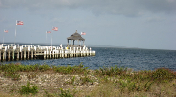 The tide gauge station in Montauk, New York, is located on the Rough Rider Condominium Pier, pictured here. The water level sensor and other monitoring equipment are located on the far side of the pier. (Photo credit: NOAA)