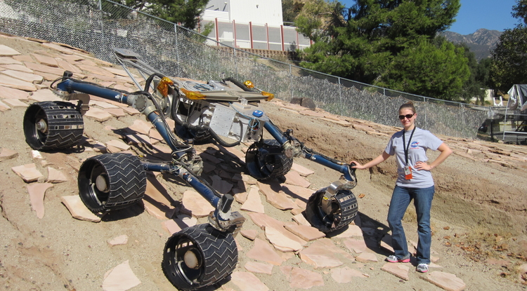 "During one of her stints at NASA's Jet Propulsion Laboratory in Pasadena, Calif., Shaunna Morrison got to play with the ""scarecrow,"" a replica of the Curiosity rover. The ""scarecrow"" lacks the instrumentation of Curiosity, but features identical wheels and base, and is exactly weighted and calibrated so it behaves as it would on Mars. ""We can control it with a smartphone, and it was pretty neat to tell it to spin its wheels this way and move backwards and things like that."" (Photo: Thomas Bristow)"