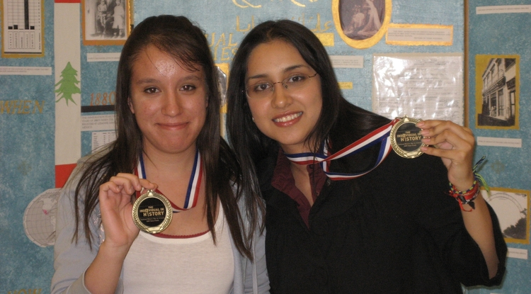 Stephanie Medina (right) and Arlene Medina show their medals from the National History Day state competition in April 2009. (Photo courtesy of Lisa Adeli).