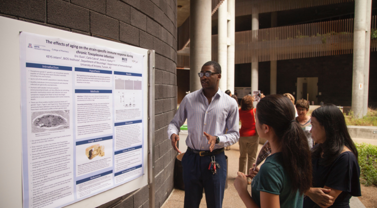 At KEYS, Eric Oum worked in the lab of Dr. Anita Koshy studying the effects of aging on the immune response to Toxoplasma gondii infection. Here, he presents his research poster at the KEYS Showcase.<br />
